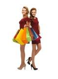 2 девочка-подростка с хозяйственными сумками Стоковое Изображение RF
