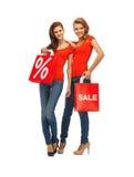 2 девочка-подростка с хозяйственными сумками Стоковое фото RF