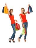 2 девочка-подростка с хозяйственными сумками Стоковая Фотография RF