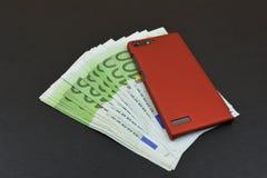 Европейские банкноты с красным телефоном Стоковое Фото