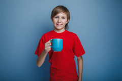 Европейский - смотреть мальчика 10 лет держа a Стоковая Фотография