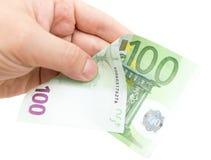 Евро в его руке на белой предпосылке Стоковая Фотография RF