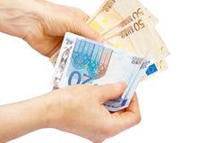 Евро в руке Стоковые Изображения RF
