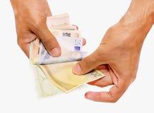 Евро в руке Стоковая Фотография