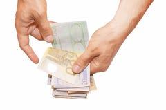 Евро в руке Стоковые Изображения