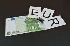 Евро знака с банкнотами Стоковая Фотография