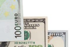 Евро и доллар на белой предпосылке Стоковая Фотография