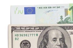 Евро и доллар на белой предпосылке Стоковое Фото