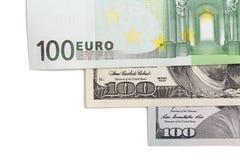 Евро и доллар на белой предпосылке Стоковые Фото