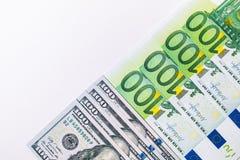 100 евро и новых 100 долларовых банкнот Предпосылка  Стоковое фото RF
