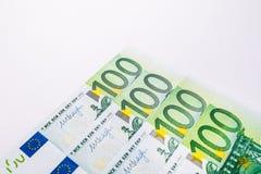 100 евро и новых 100 долларовых банкнот Предпосылка  Стоковое Изображение RF
