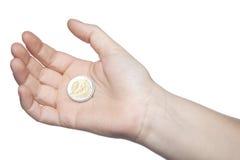 2 евро на руке, белой предпосылке Стоковое Изображение RF