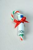 100 евро с красной тросточкой ленты и конфеты Стоковое Изображение RF