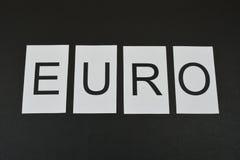 ` Евро ` слова на черной предпосылке Стоковое Изображение