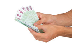 100 евро Banknots в руке Стоковое Фото