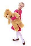 девушка медведя держа меньший игрушечный Портрет полностью Стоковое Изображение