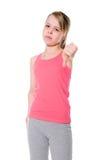девушка показывать большие пальцы руки вниз над белизной Стоковое фото RF