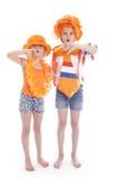 2 девушки в апельсине с большими пальцами руки вниз Стоковая Фотография