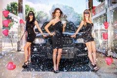 3 девушки в масках Стоковые Изображения