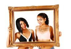 2 девушки в рамке. Стоковые Изображения
