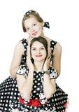 2 девушки в стиле pin-вверх на белой предпосылке Стоковые Фотографии RF
