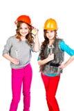 2 девушки в шлемах конструкции Стоковое Изображение RF
