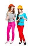 2 девушки в шлемах конструкции Стоковая Фотография RF