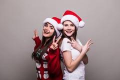 2 девушки в шляпе Санты Стоковое Изображение RF