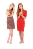 2 девушки держа свежую грушу Стоковая Фотография RF
