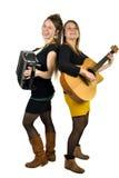 2 девушки играя музыку Стоковое Изображение