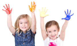 2 девушки с краской на руках Стоковое Изображение