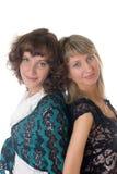 2 девушки на белой предпосылке Стоковая Фотография
