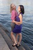 2 девушки около воды Стоковое фото RF