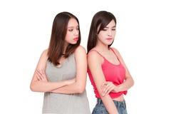 2 девушки смотря один другого сердитый Стоковая Фотография