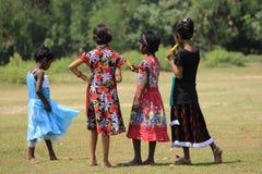 4 девушки с красочными платьями Стоковое Изображение