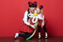 2 девушки с масками мыши Стоковое Фото
