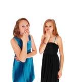 2 девушки с ртом рук вон там Стоковое Изображение RF