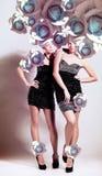 2 девушки с стилем причёсок Стоковая Фотография RF