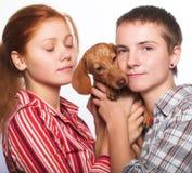 2 девушки с тарифом Стоковое Фото