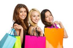 3 девушки с хозяйственными сумками Стоковое Изображение RF