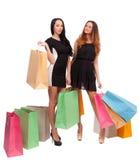 2 девушки с хозяйственными сумками Стоковая Фотография