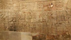 Египетский высекать на каменной стене Стоковое Фото