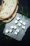Еда здорового питания - сыр фета на черной предпосылке стоковые изображения