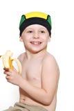 еда мальчика повязки банана Стоковая Фотография