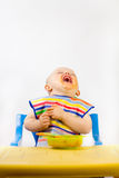 еда младенцев первая стоковое фото