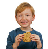 еда печенья мальчика Стоковые Изображения RF
