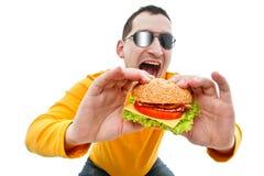 еда человека гамбургера Стоковое Изображение RF
