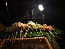 Еды и овощи зажаренные с перцем Сычуань были известно приправлять Xishuangba стоковое изображение rf