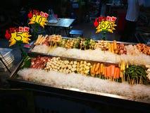 Еды и овощи зажаренные с перцем Сычуань были известно приправлять Xishuangba Стоковые Изображения