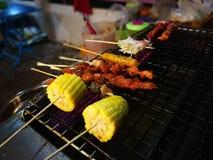 Еды и овощи зажаренные с перцем Сычуань были известно приправлять Xishuangba Стоковое фото RF